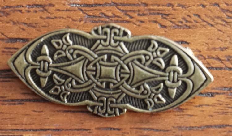 """Broche  """" Keltische teken """" koper kleurig"""