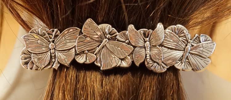 """Haarclip """" Vlinders """" nikkel kleurig"""